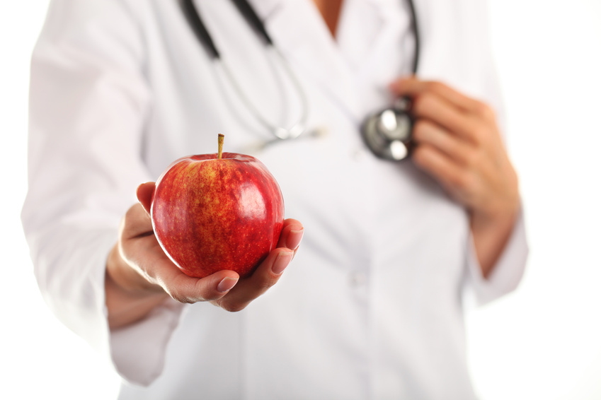 Female doctor with apple